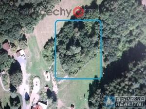 foto Pozemek 2.113 m2 se vzrostlým porostem v okrajové části obce Újezd.